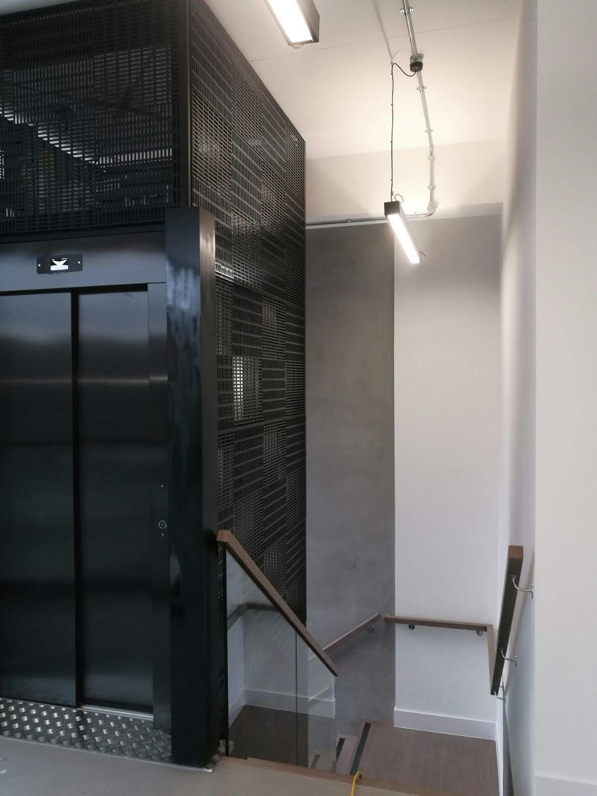 Bespoke cladding for lift shaft. </br><a href='bespoke1.html'>Click here to see more pictures of the lift cladding!</a> </br><a href='staircase6.html'>Click here to see more pictures of the staircase!</a>