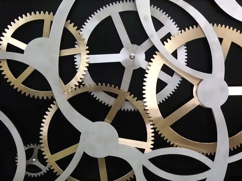 Decorative bespoke stainless and brass cog display