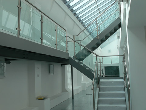 Steel staircase, with pan treads and stainless steel and glass balustrade