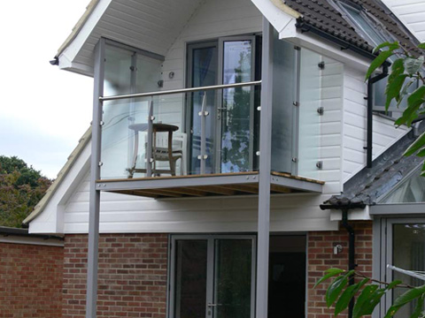 Metal balcony with stainless steel handrail