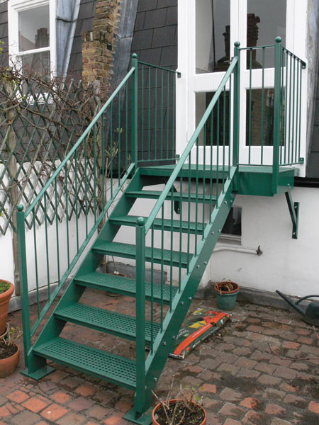 A steel staircase cast iron treads, finished with a hot zinc spray and powder coated to the customers choice of colour, fitted on a London roof top terrace.
