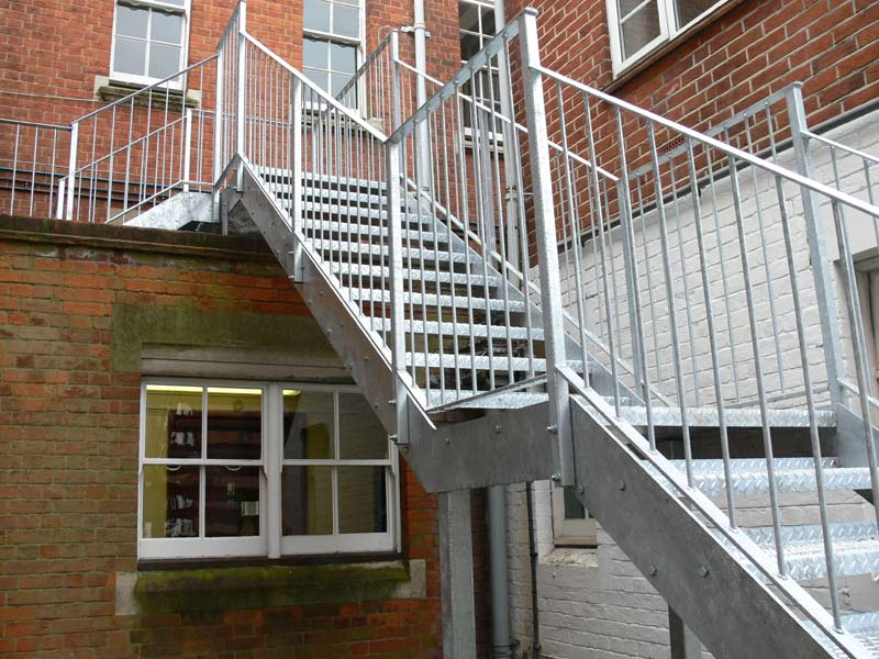 External fire escape, galvanised staircase for a local school, simple handrail design. Perfect practical, cost effective and compliant solution.