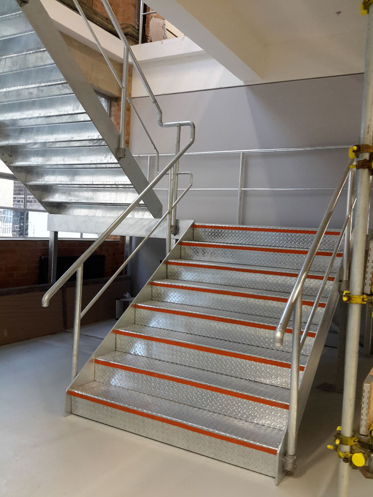 Internal galvanised staircase with folded durbar treads and handrail.</br><a href='staircase1.html'>Click here to see more pictures of this staircase!</a>