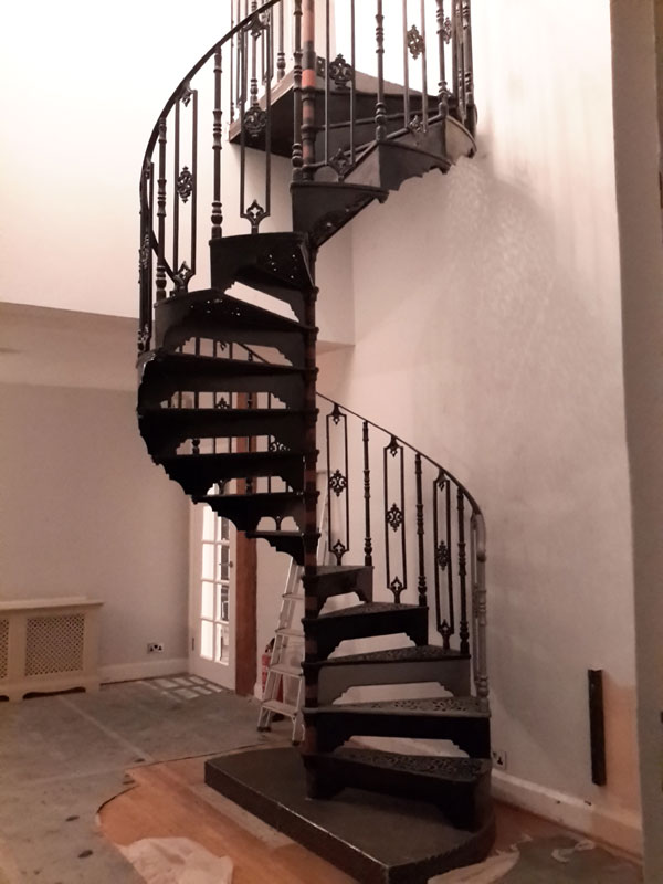 Bespoke spiral staircase with landing