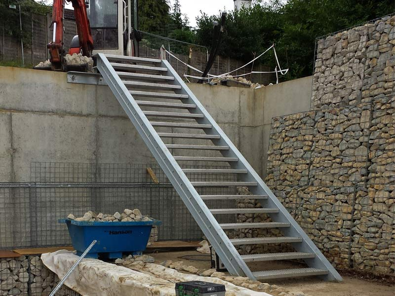 External staircase with perforated stainless steel treads and hot dip galvanised steel channel stringers.